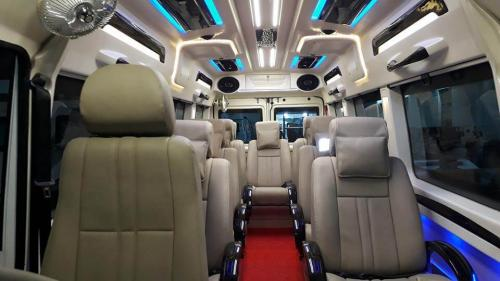 9 seater tempo traveller interior